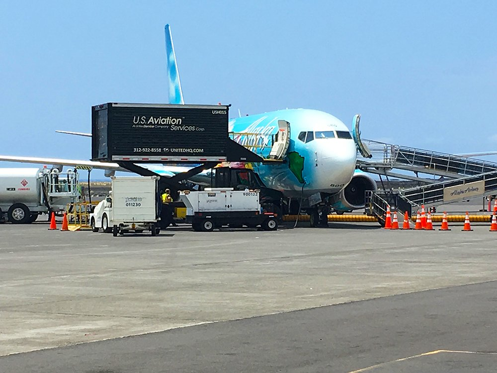 Alaska Airlines plane in Kailua-Kona Airport on the Big Island of Hawaii, Kohala Coast Vacation Rentals, Exotic Estates, Vacation Rentals